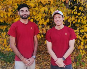 Two young male students in red branded Boosted Chews t-shirts.
